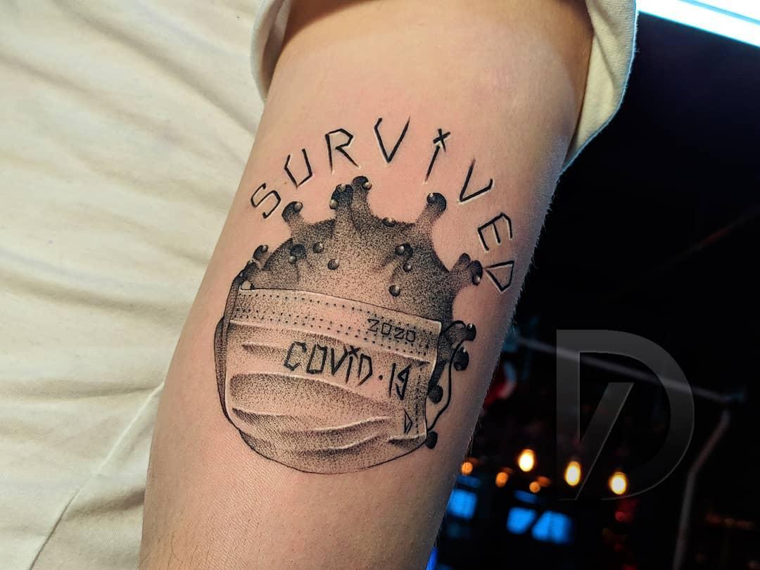 Upperarm COVID Tattoo -d.vol_tattoo