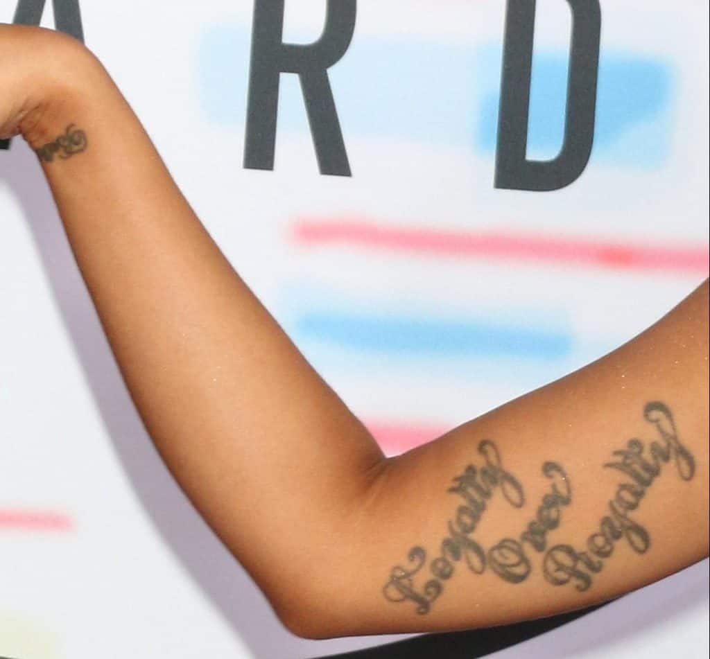 Cardi B Wrist And Loyalty Tattoo Right Arm