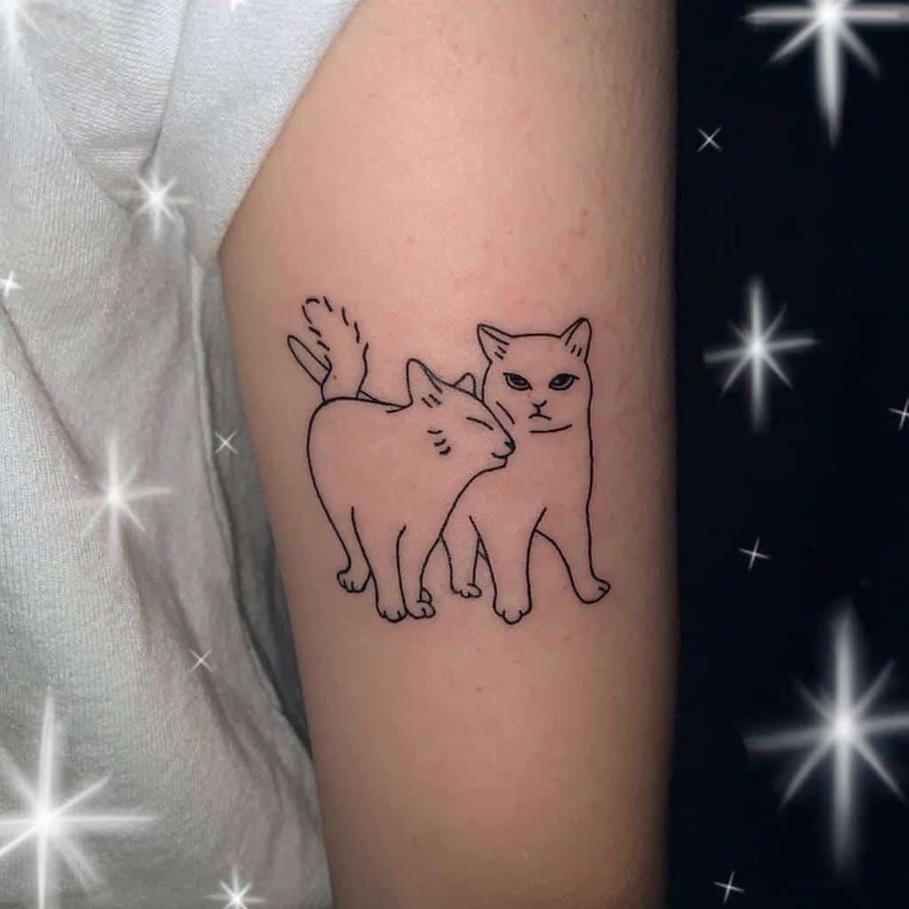 Cat Outline Upperarm Tattoo tattoo_toon