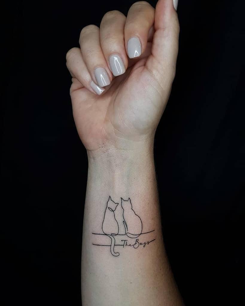 Cat Outline Wrist Tattoo dha_tattoo14