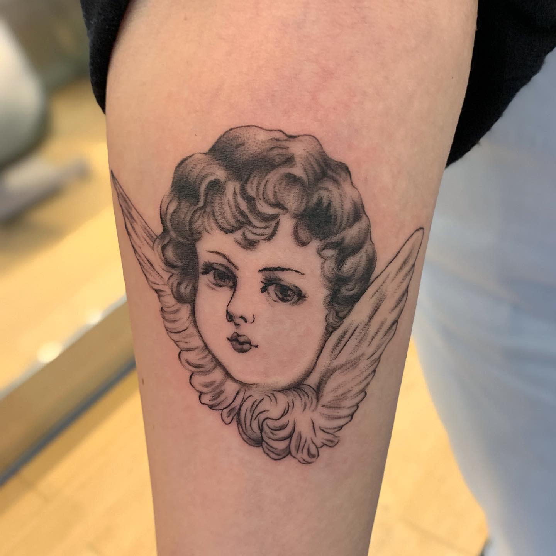 Cute Cherub Tattoo -elm.jpeg