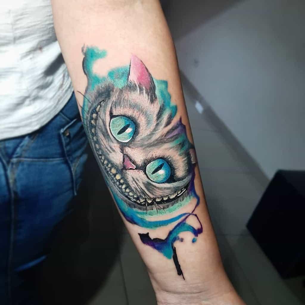 Cheshire Cat Forearm Tattoo pierrecwb