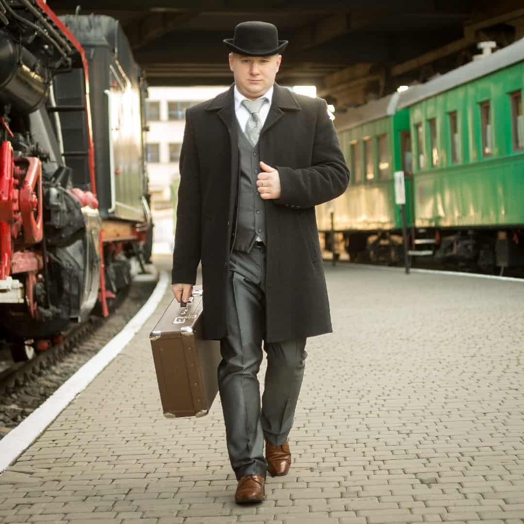 Handsome,Man,In,Retro,Suit,With,Suitcase,Walking,On,The
