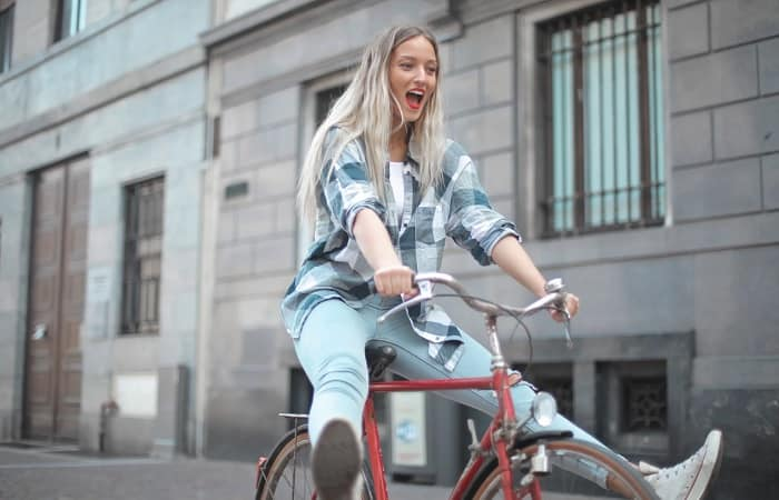 Girl Riding Bicycle In City