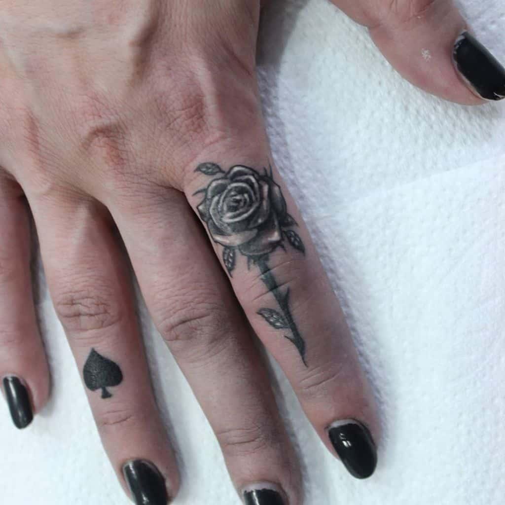 Delicate Flower Finger Tattoos sindjel_tattoo_piercing