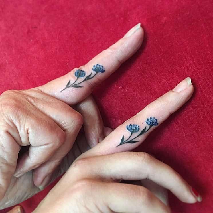 Delicate Flower Finger Tattoos terran.tattooart_css