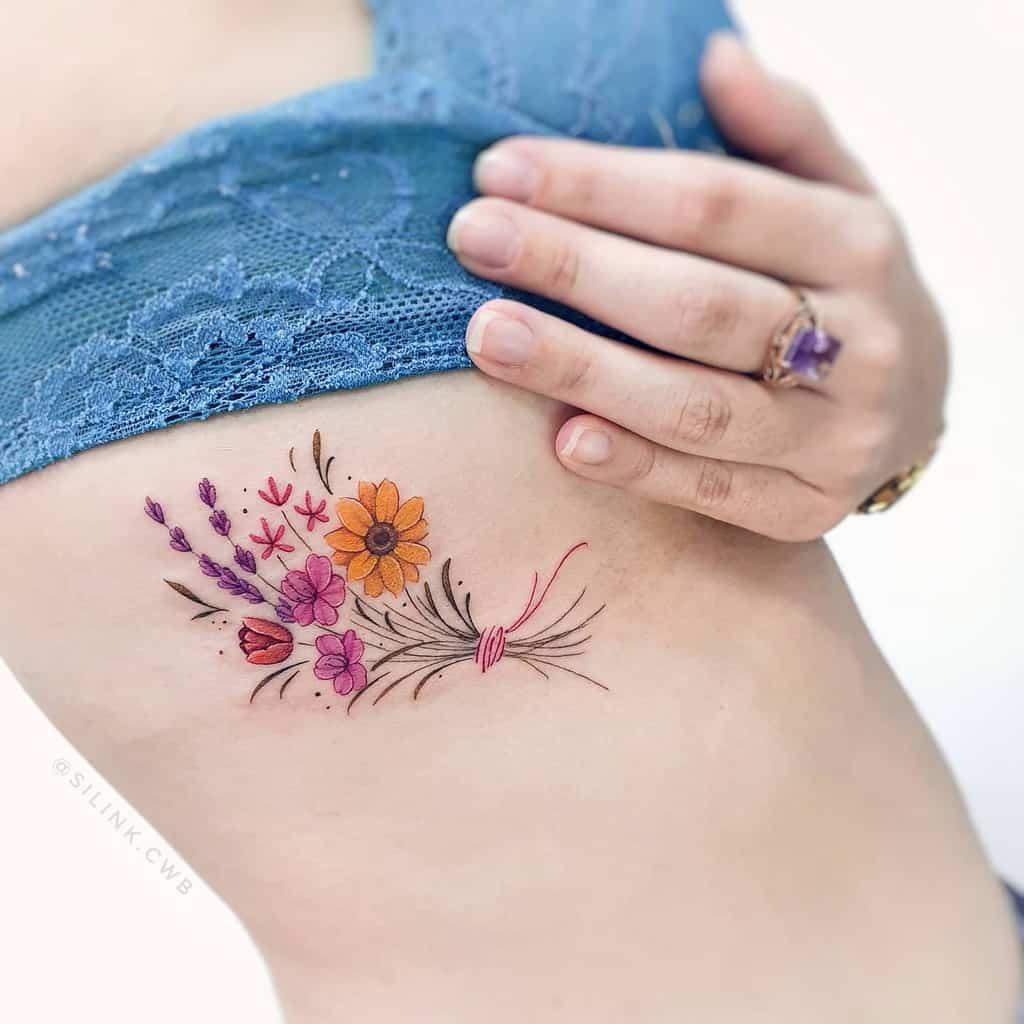 Delicate Flower Rib Tattoos silink.cwb