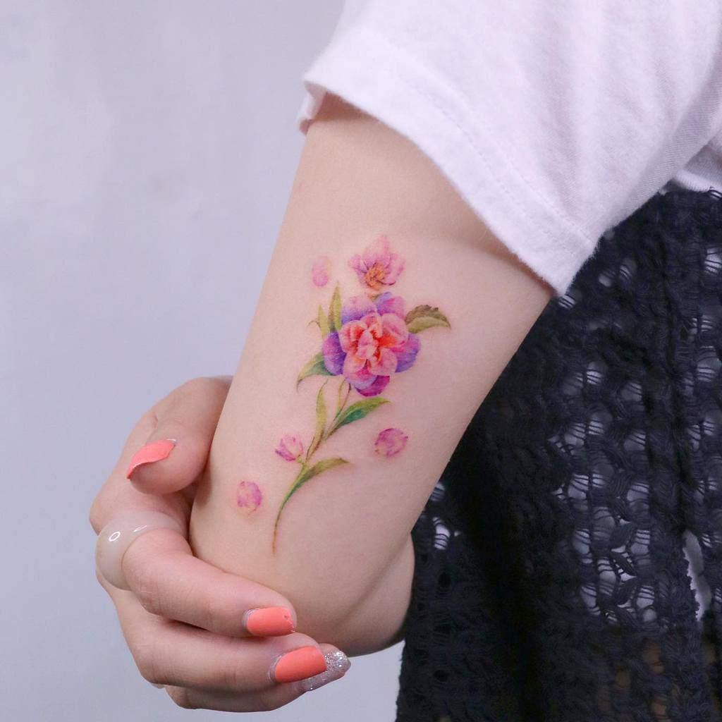 Delicate Flower Upperarm Tattoos 2 tilda_tattoo