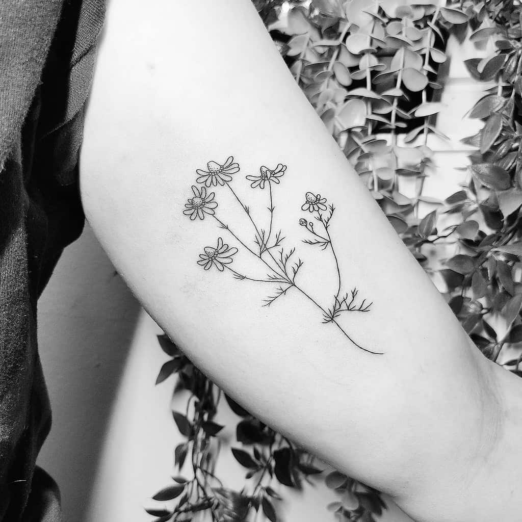 Delicate Flower Upperarm Tattoos tattoosbyina