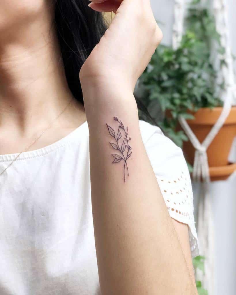 Delicate Flower Wrist Tattoos thelittleloft