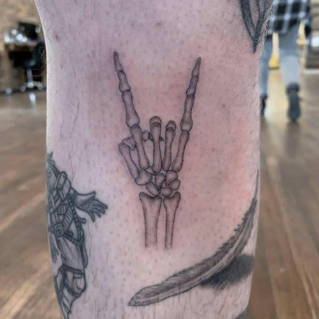 fineline-skeleton-rocker-hand-single-needle-tattoo-ethan.oberholzer