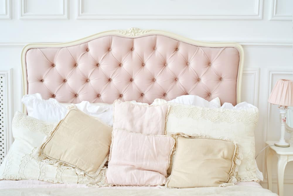 Large,Buttoned,Headboard,Of,Luxury,Bed,,Beige,And,Pink,Pillows