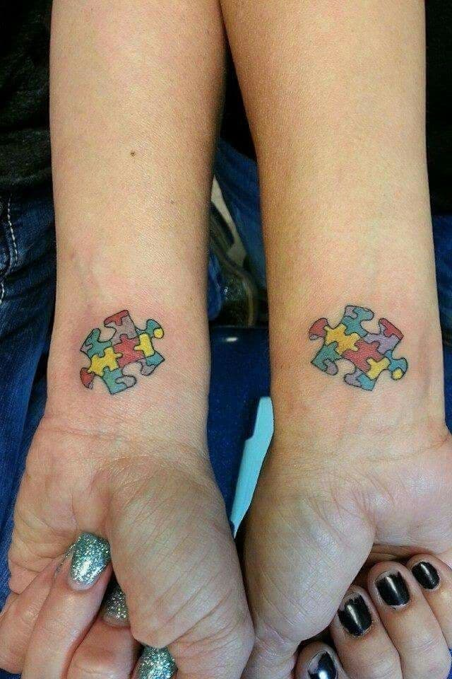 Full color matching wrist tattoo of multi-colored puzzle pieces.