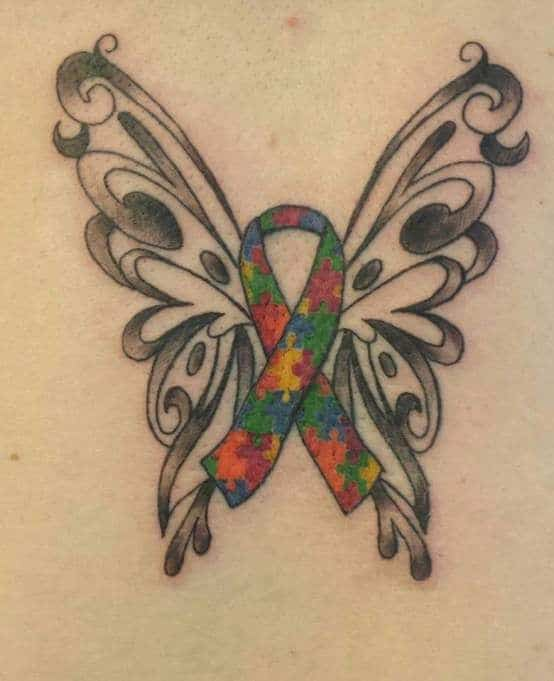 Full color tattoo of Autism Awareness Puzzle ribbon with stylized butterfly wings.