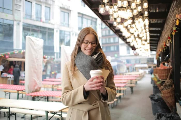 Girl At Market Holding Coffee