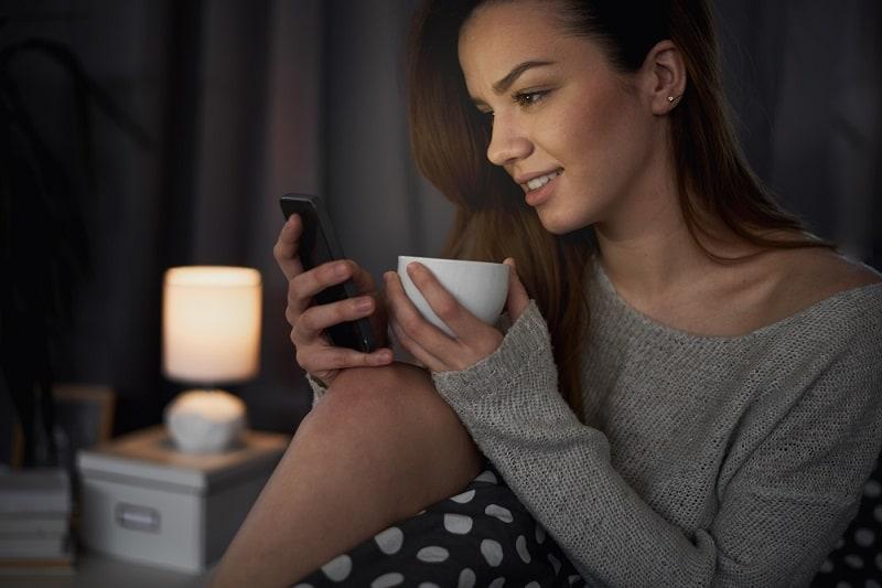Girl Looking At Phone At Night