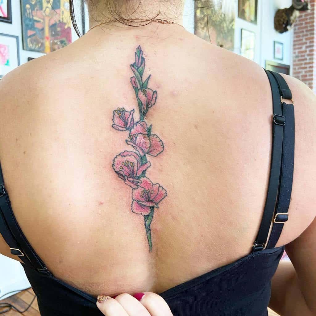 Gladiolus Flower Back Tattoo msdaisytattoos