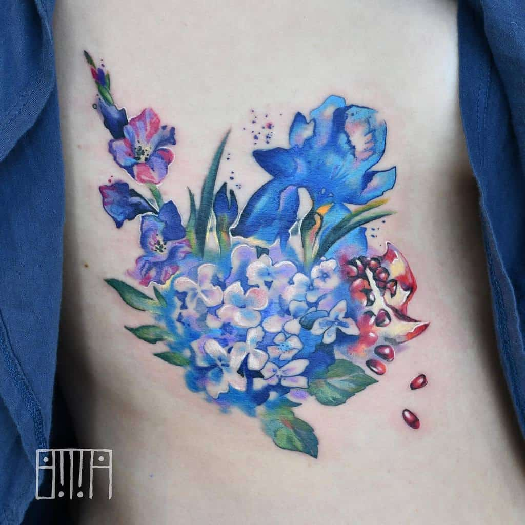 Gladiolus Flower Rib Tattoo emmagracetattoo