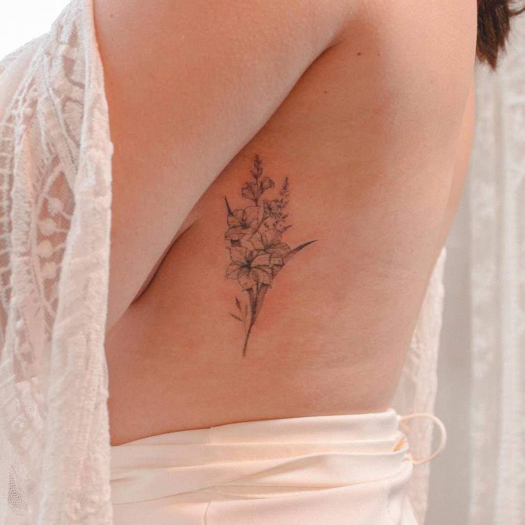 Gladiolus Flower Rib Tattoo rickiestattoo