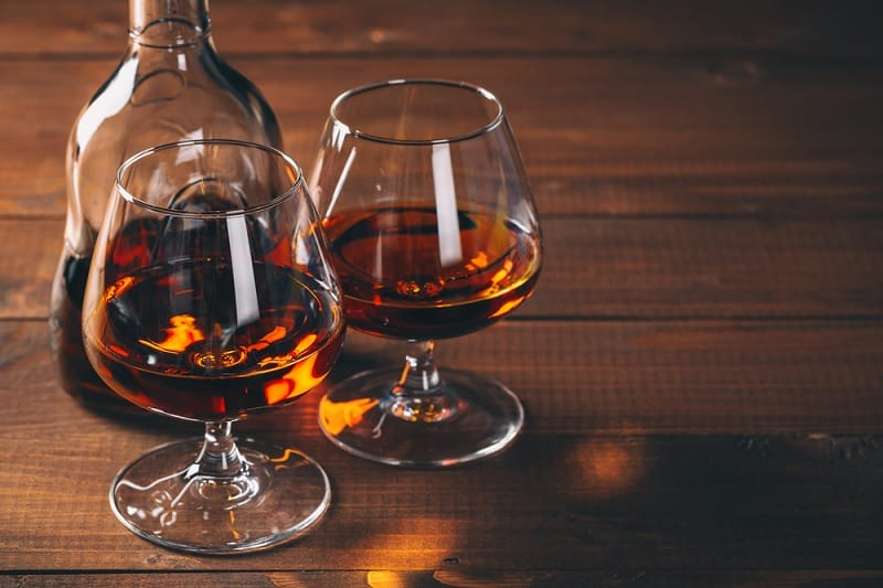 Glasses Of Cognac And Bottle