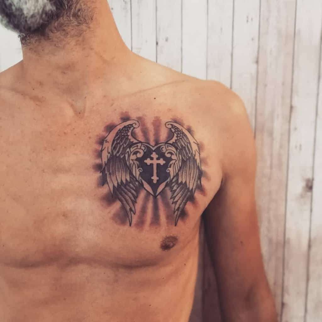 Heart With Wings Chest Tattoo dualtattoo