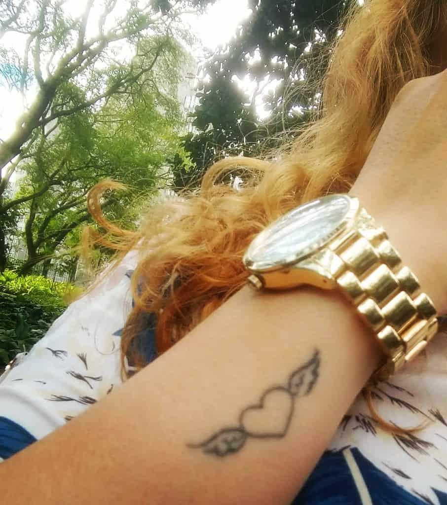 Heart With Wings Wrist Tattoo tassiadella