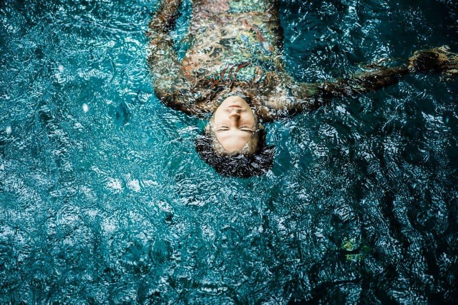 Heavily Tattooed Man Swimming