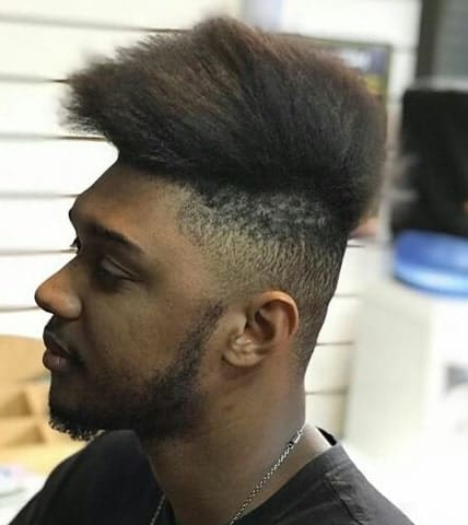 Hi Top Fade Haircut With Long And Messy Hair On Top Paired With A Clean Fade On The Sides And Back