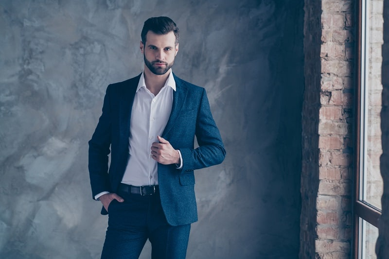 Portrait,Of,Minded,Entrepreneur,Looking,Touching,His,Modern,Jacket,Blazer