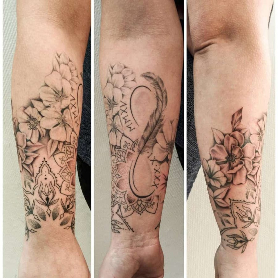 Infinity Feather Linework Womens Tattoo