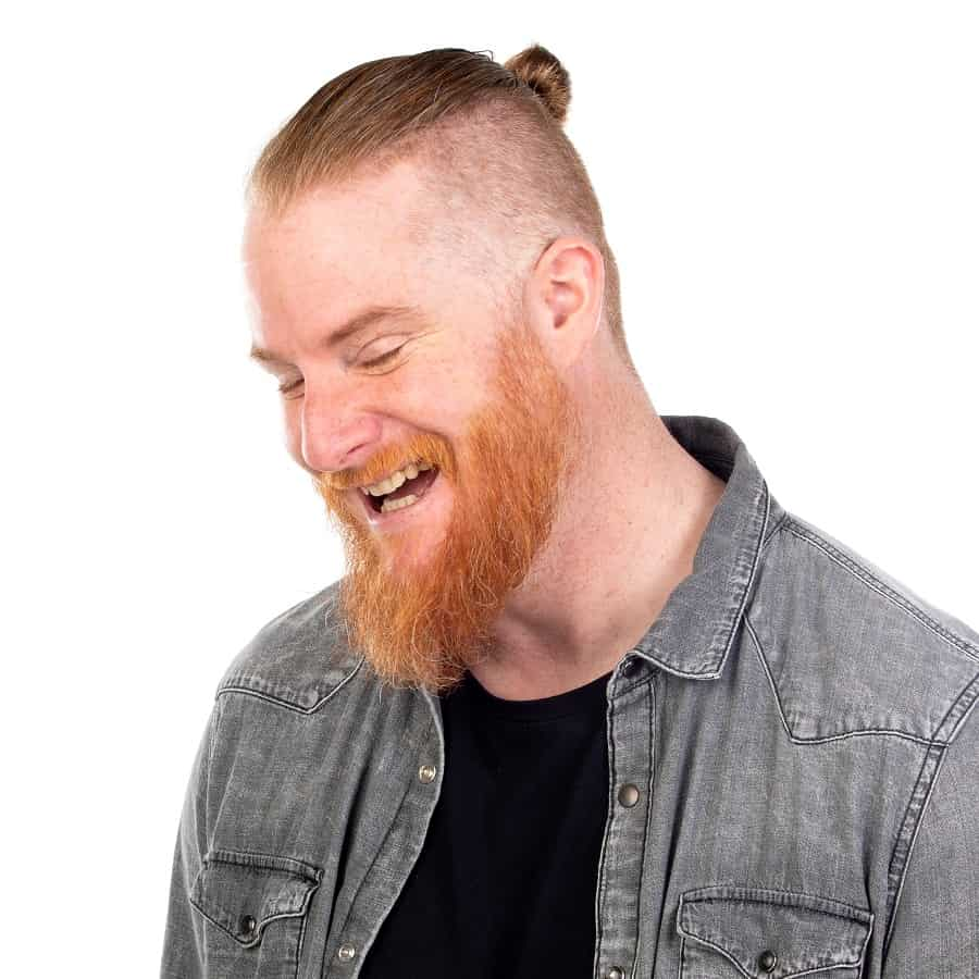Man Bun Paired With Fade And Thick Beard