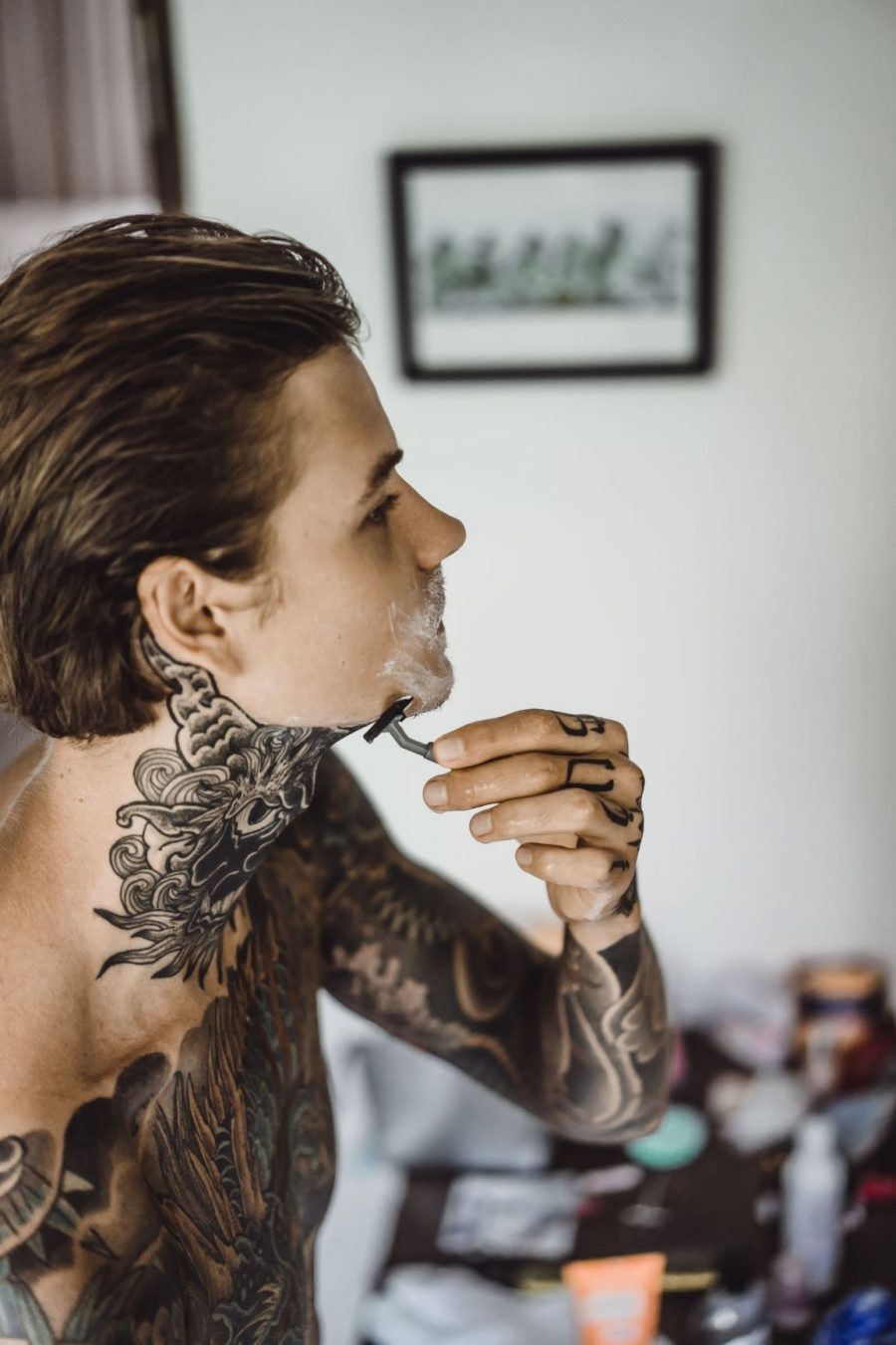 Man Shaving Tattooed Skin 2