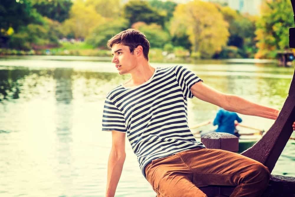 Man In Boat Wearing Corduroy Pants