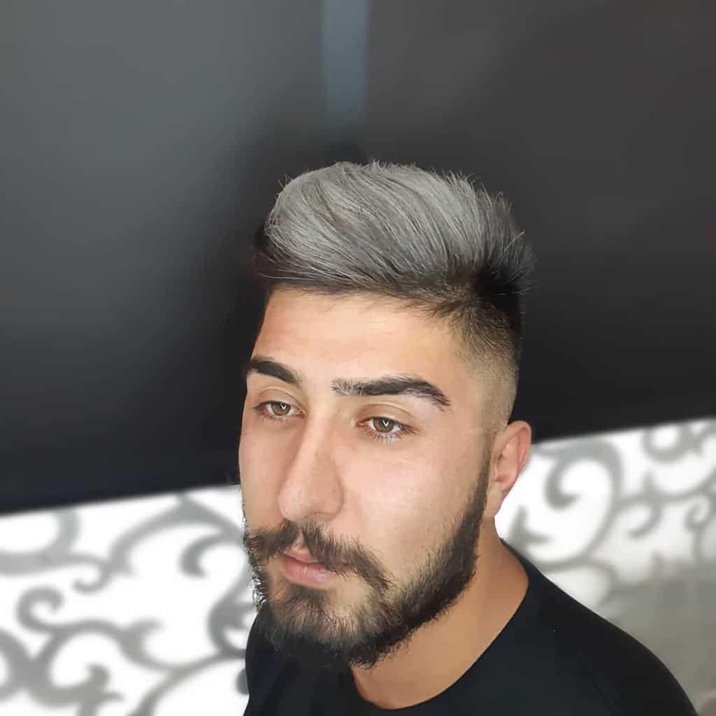 Man with blond highlights and dark facial hair-shahryar.aria