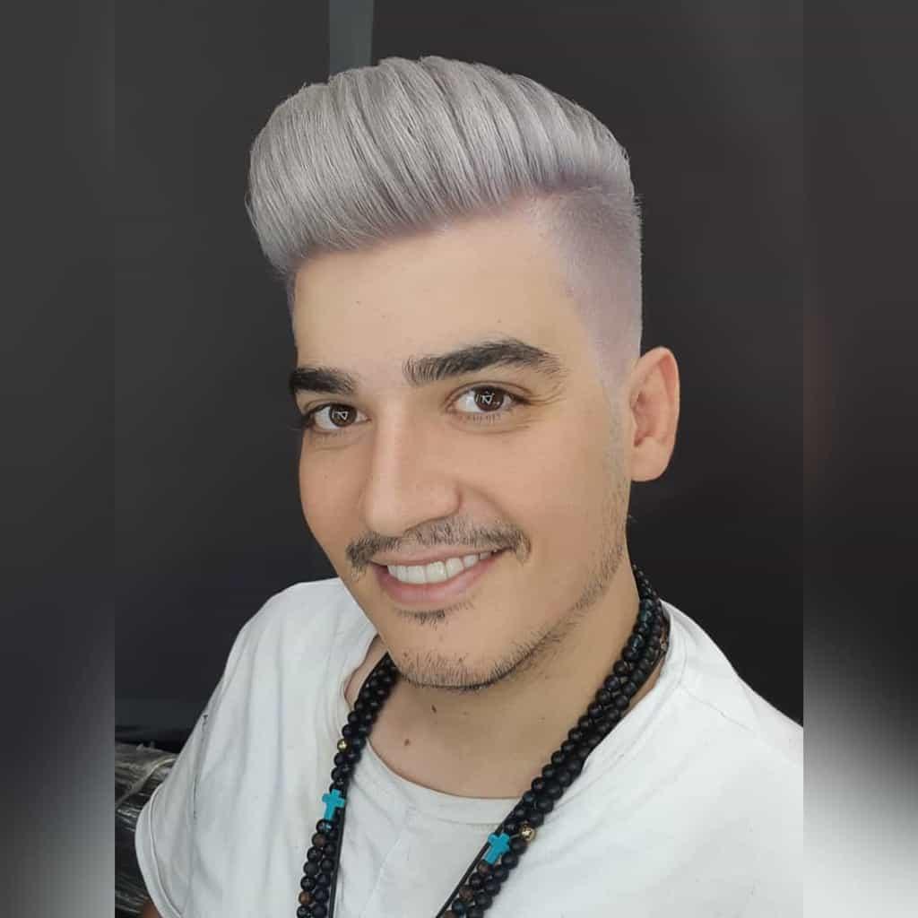 Man with blond highlights and facial hair-shahryar.aria