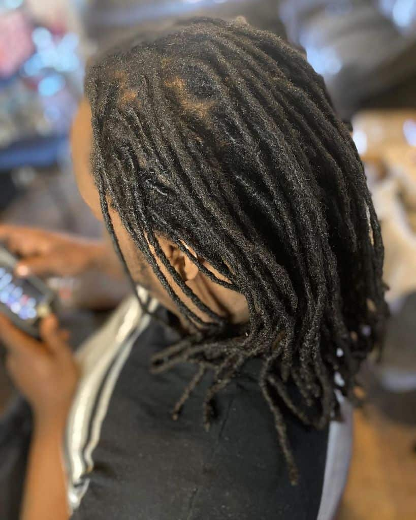 Man With Dreadlock Hairstyle Featuring Medium Length Dreads