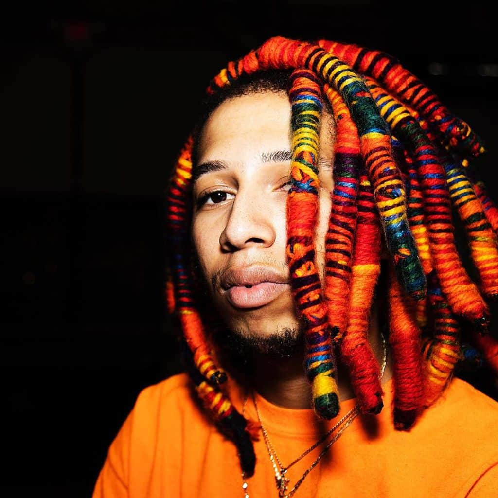 Man With Dreadlocks With Yarn Wraps Of Different Shades