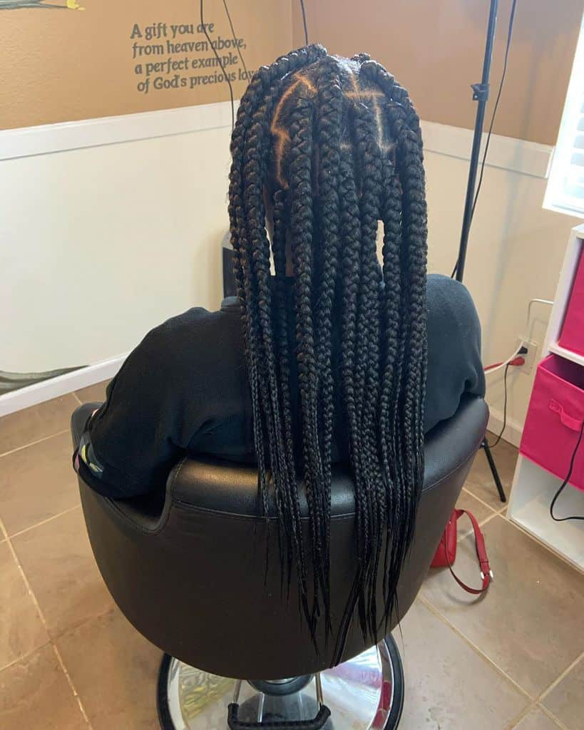 Men's Box Braids And Long Braided Hair Held At The Top With An Elastic Band