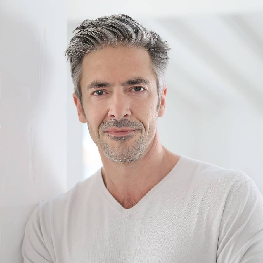 Middle Aged Man With Slick Back Hairstyle