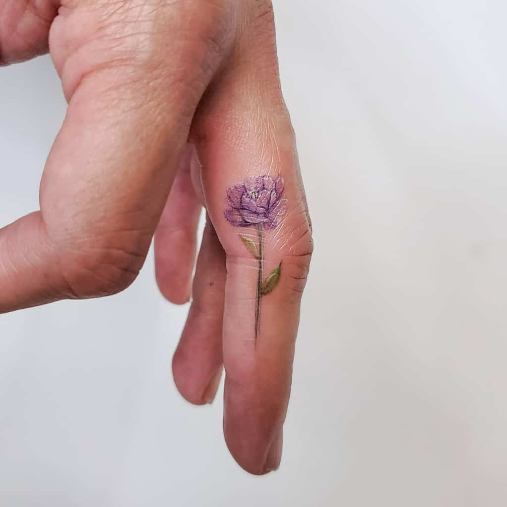 Minimalist Flower Finger Tattoo sherriaustria
