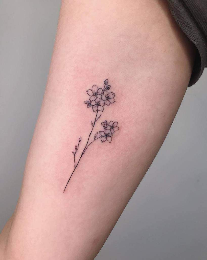 Minimalist Flower Upperarm Tattoo ethereal.tattoo