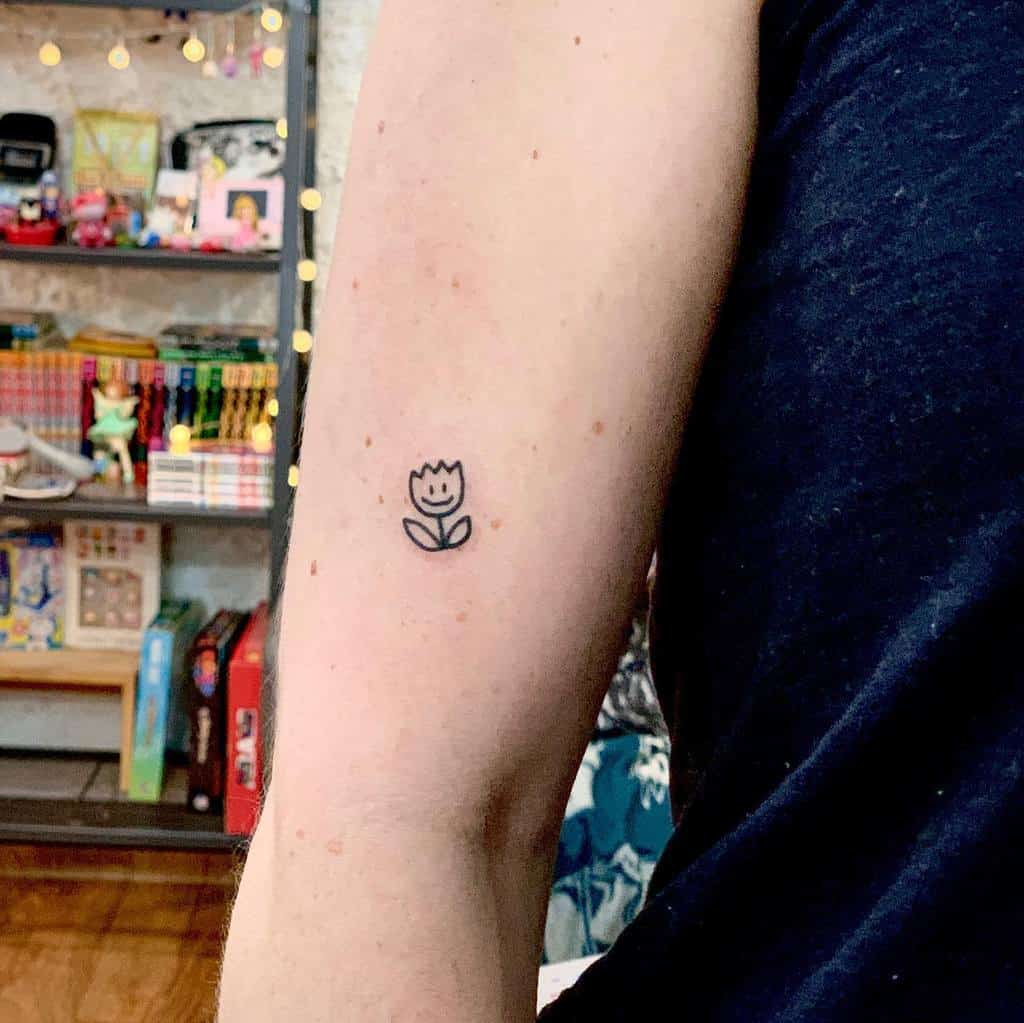 Minimalist Flower Upperarm Tattoo trashmtattoo