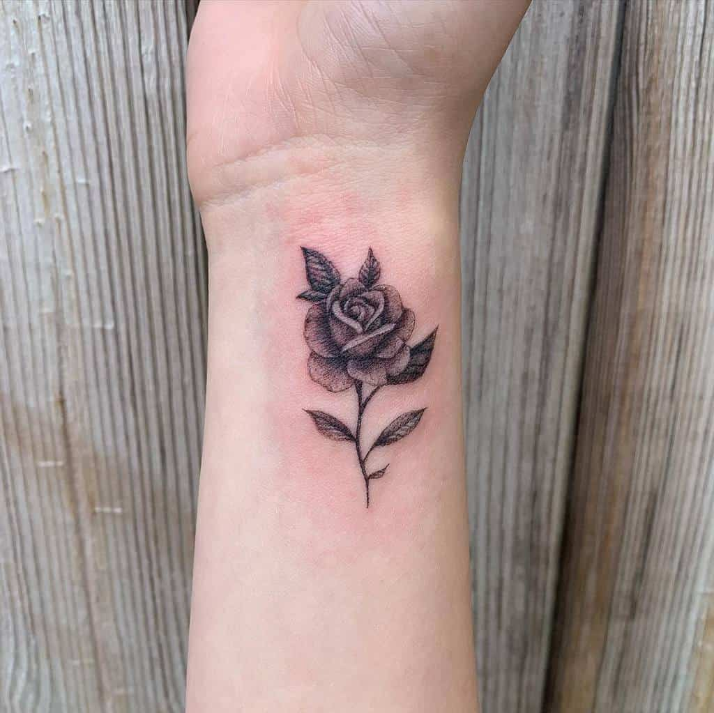 Minimalist Flower Wrist Tattoo becca_tattoo