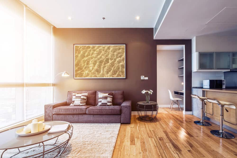 Living,Room,With,Big,Window,Interior.,Big,Picture,On,Brown