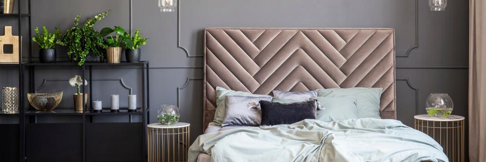 Bed,With,Headboard,Between,Gold,Tables,In,Grey,Bedroom,Interior