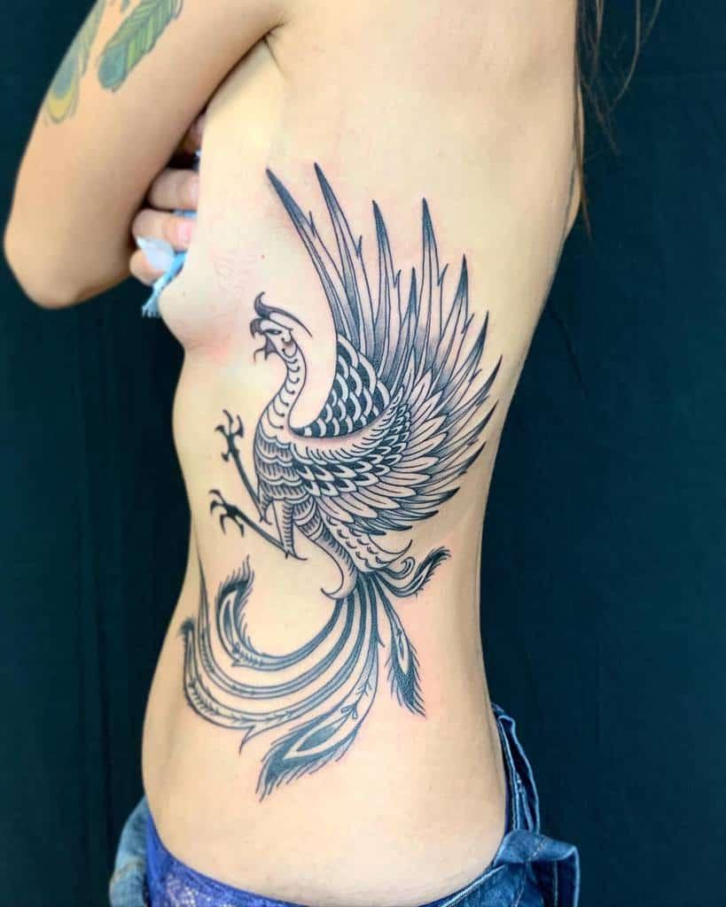 Phoenix Rising Feminine Tattoo volttatouage
