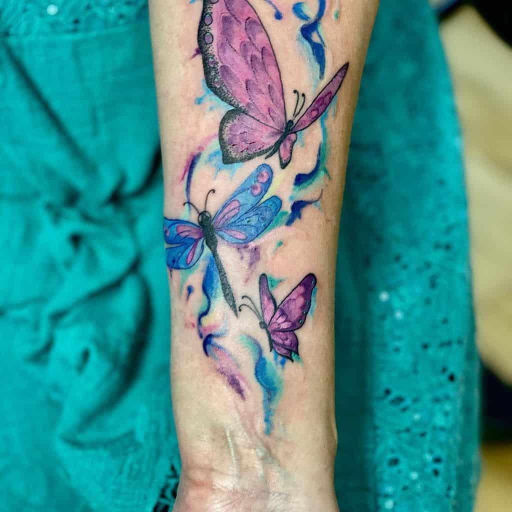 Purple Butterfly Forearm Tattoo inkscapetattoo