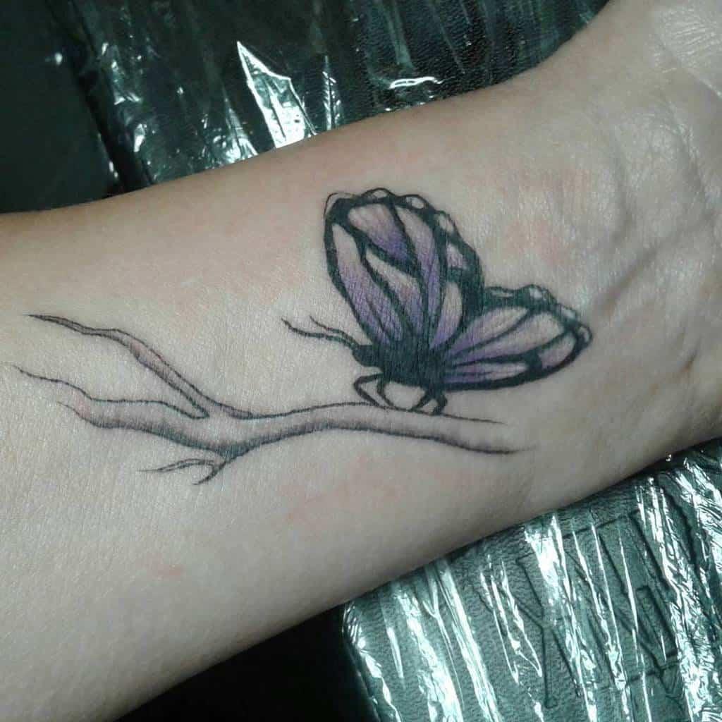 Purple Butterfly Wrist Tattoo absolutetattoo785