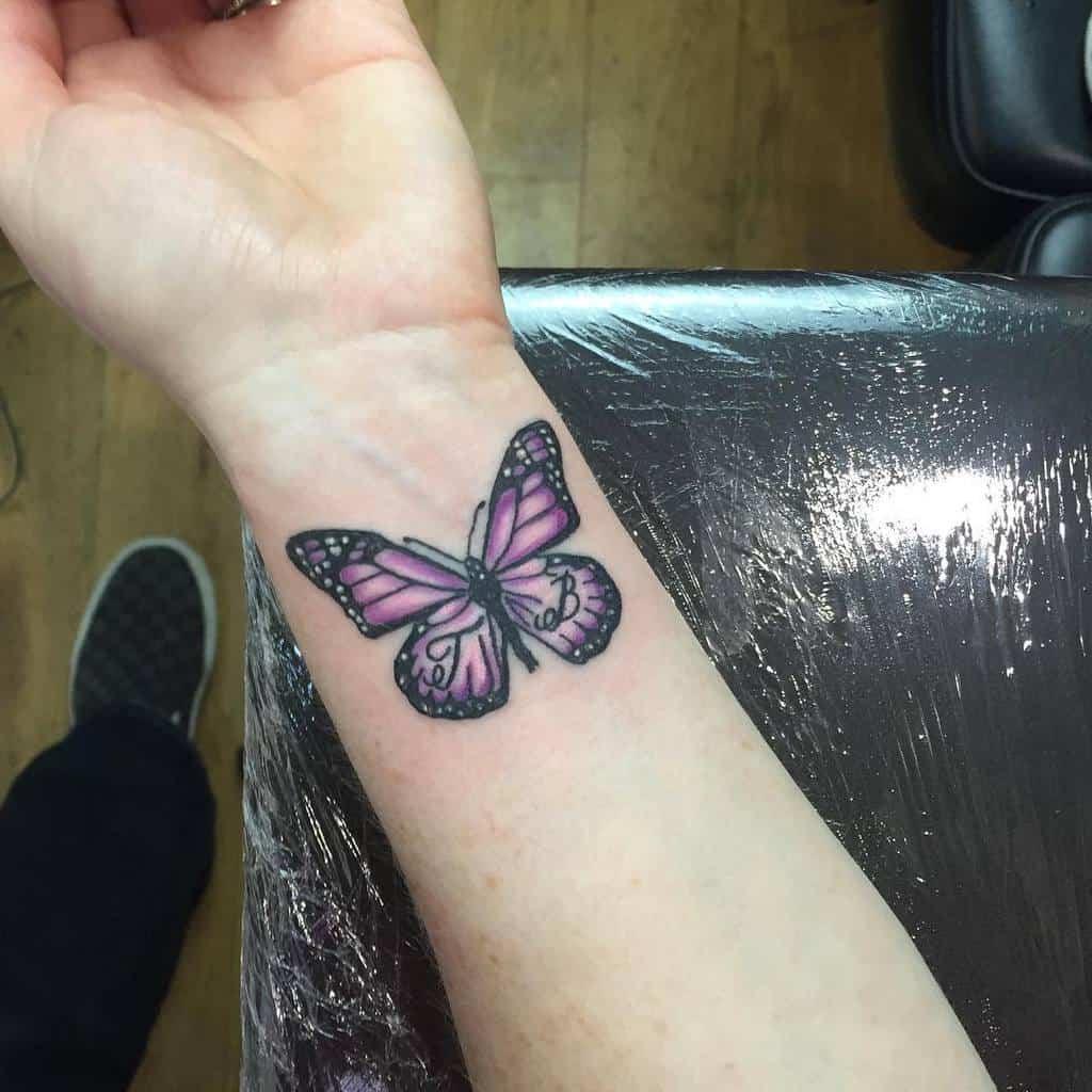 Purple Butterfly Wrist Tattoo johnboystattoos