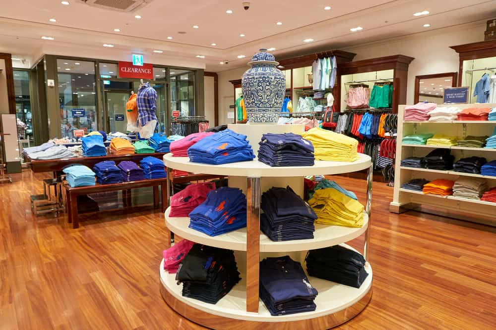 Ralph Lauren polos stacked on a shelf in the store